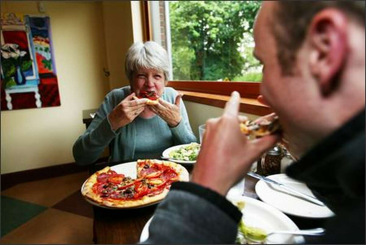 Pat Chemnick and her son, Bill, enjoy Pinocchio pizza and mushroom pizza for dinner at Mioposto.