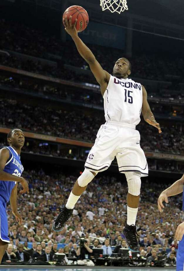 Kemba Walker #15 of the Connecticut Huskies goes to the hoop against the Kentucky Wildcats during the National Semifinal game of the 2011 NCAA Division I Men's Basketball Championship at Reliant Stadium on April 2, 2011 in Houston, Texas.  (Photo by Andy Lyons/Getty Images) Photo: Andy Lyons, Getty Images / 2011 Getty Images
