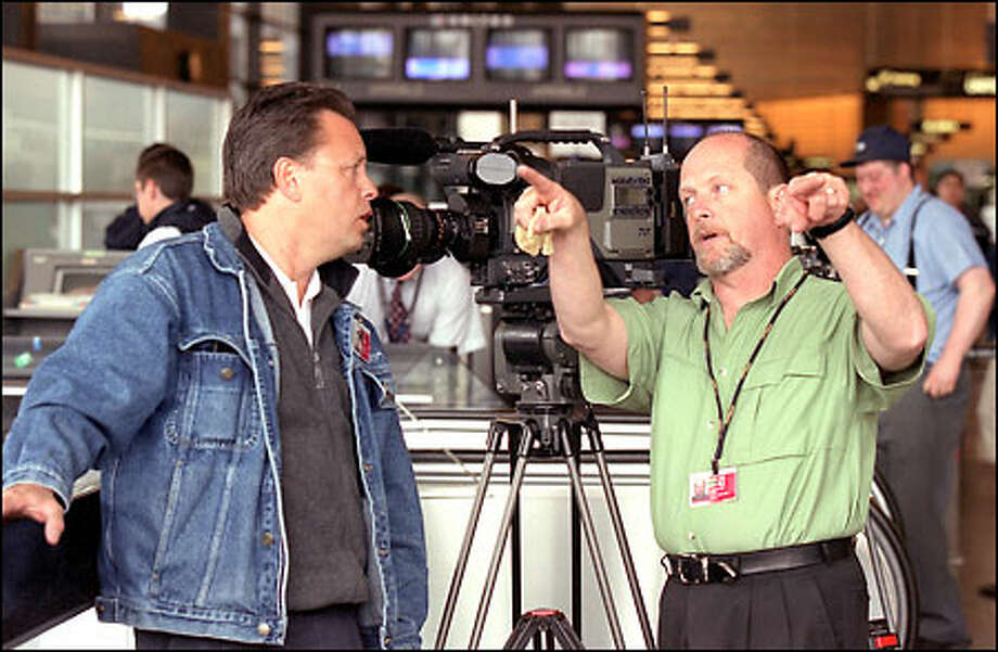 Mark Anderson and Jeff Erwin of Digital Production Services Inc. plan a movie shoot for the Port of Seattle at Sea-Tac Airport. Photo: Phil H. Webber, Seattle Post-Intelligencer / Seattle Post-Intelligencer