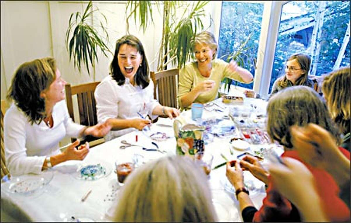 Members of Women Who Run With Glue Guns seek self-expression and hands-on fulfillment through crafts groups. Working on a bead project at a recent gathering were, from left, Julie O'Brien, Kitty Harmon, Jane Jeszeck and her daughter, Anna Jeszeck.