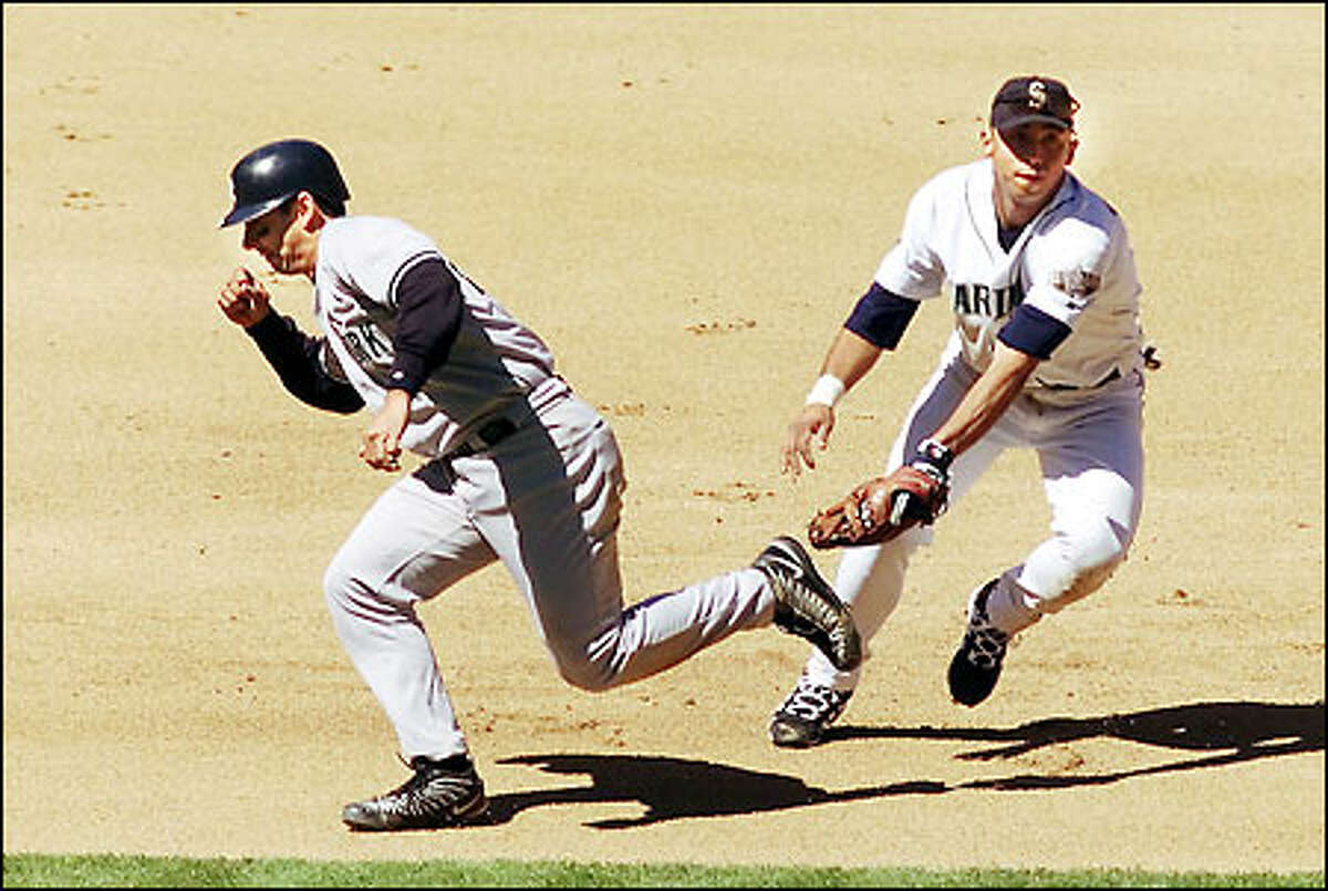 Mariners' Carlos Guillen tags NY's Jorge Posada then runs to second base to force out Scott Brocius for an unassisted double play.