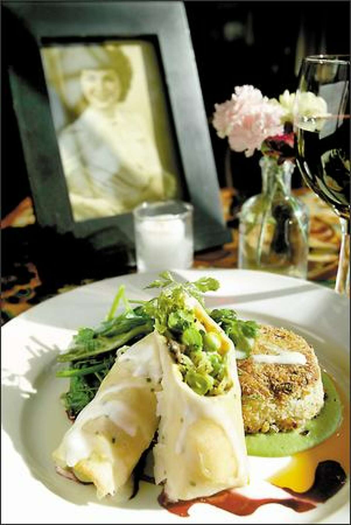 Crepes with English peas, morels and sauteed leeks are served with a pan-seared bean cake at Carmelita's, named for the woman in the photo, the mother of co-owner Michael Hughes.