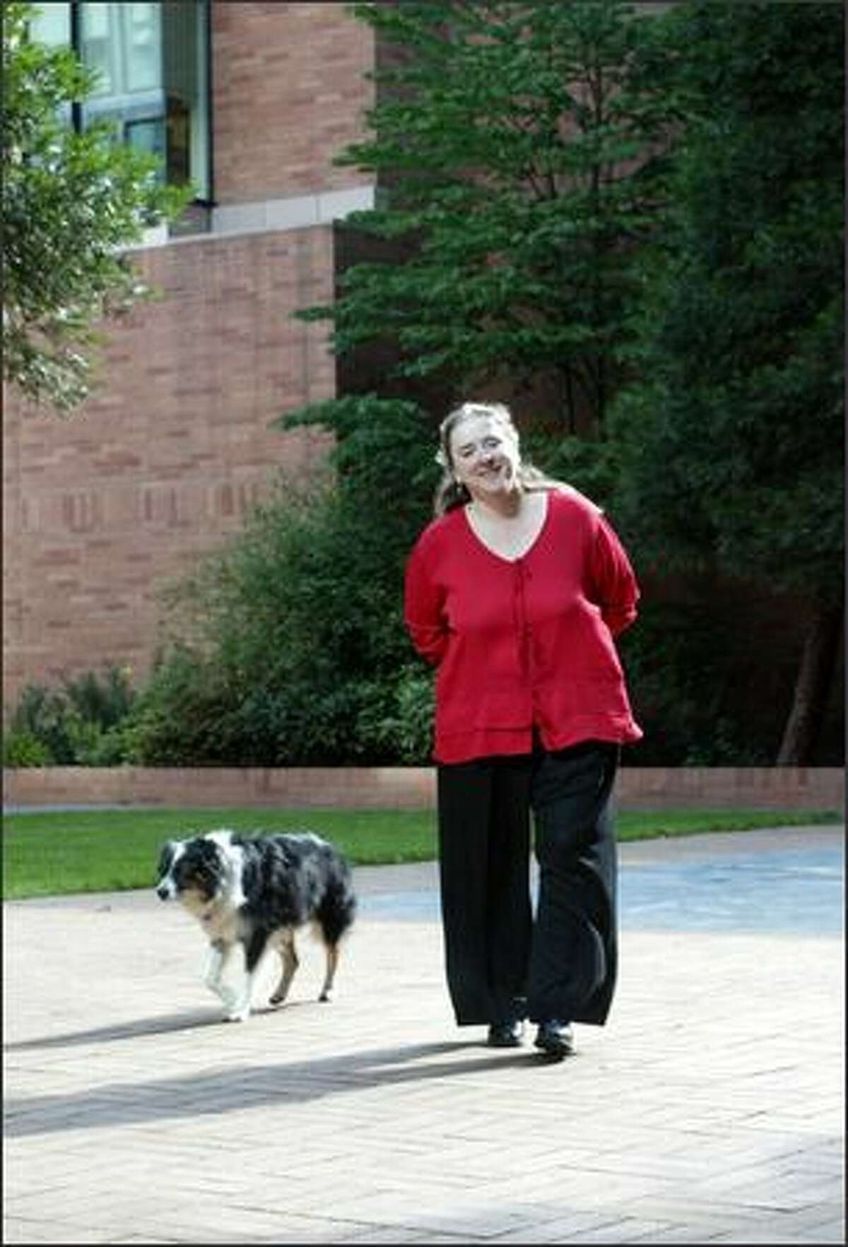 Dr. Elaine Ostrander and her border collie, Tess, 10, at the Fred Hutchinson Cancer Research Center. She hopes to find keys to human diseases in dogs.