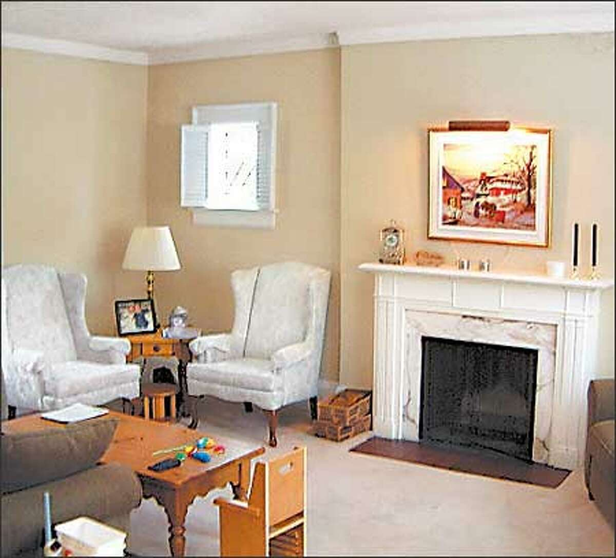 Before: Previously there was no focal point in the living room. We started by fixing the fireplace, then added color to the walls.