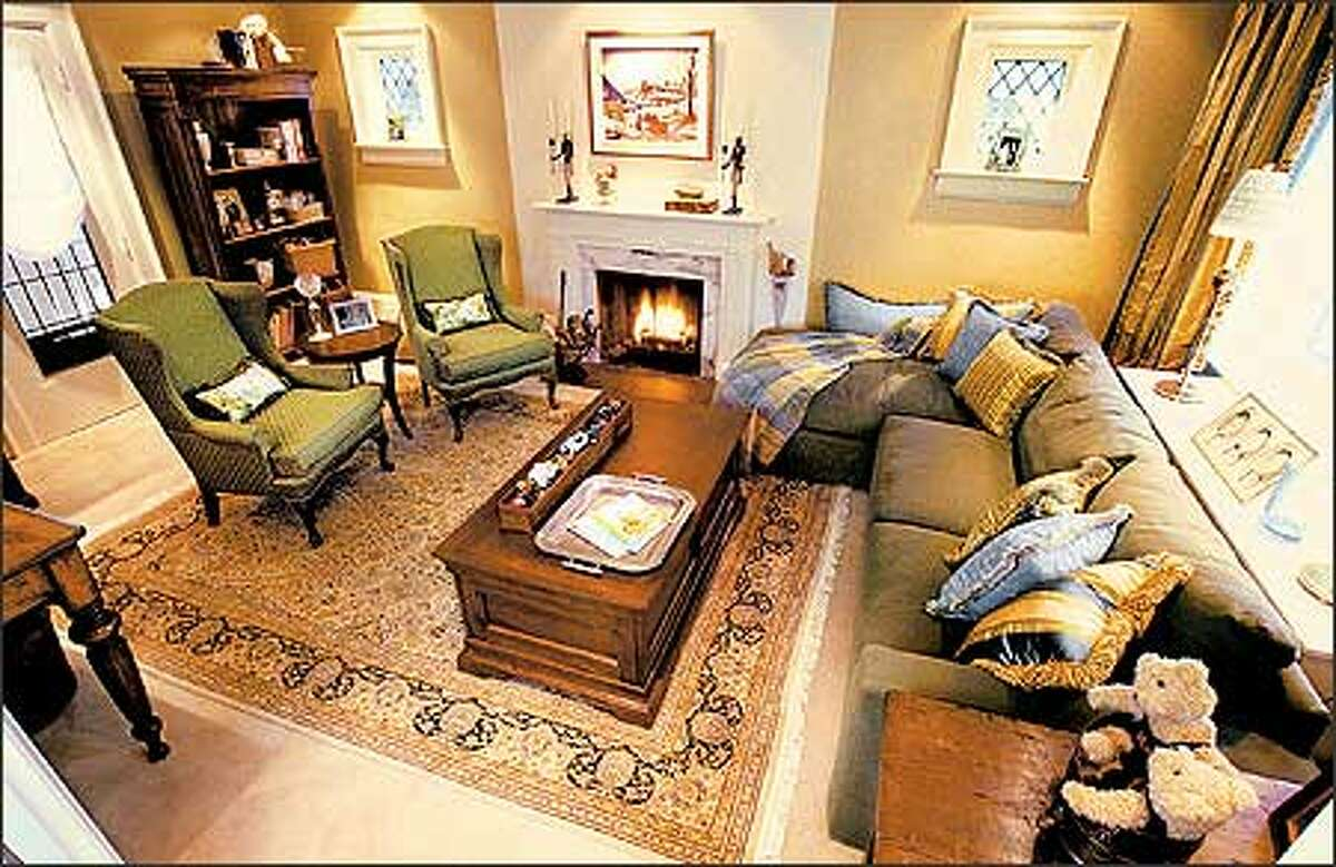 After: This living room was brought out of its boring beige past and into a bright future of sophistication and comfort.