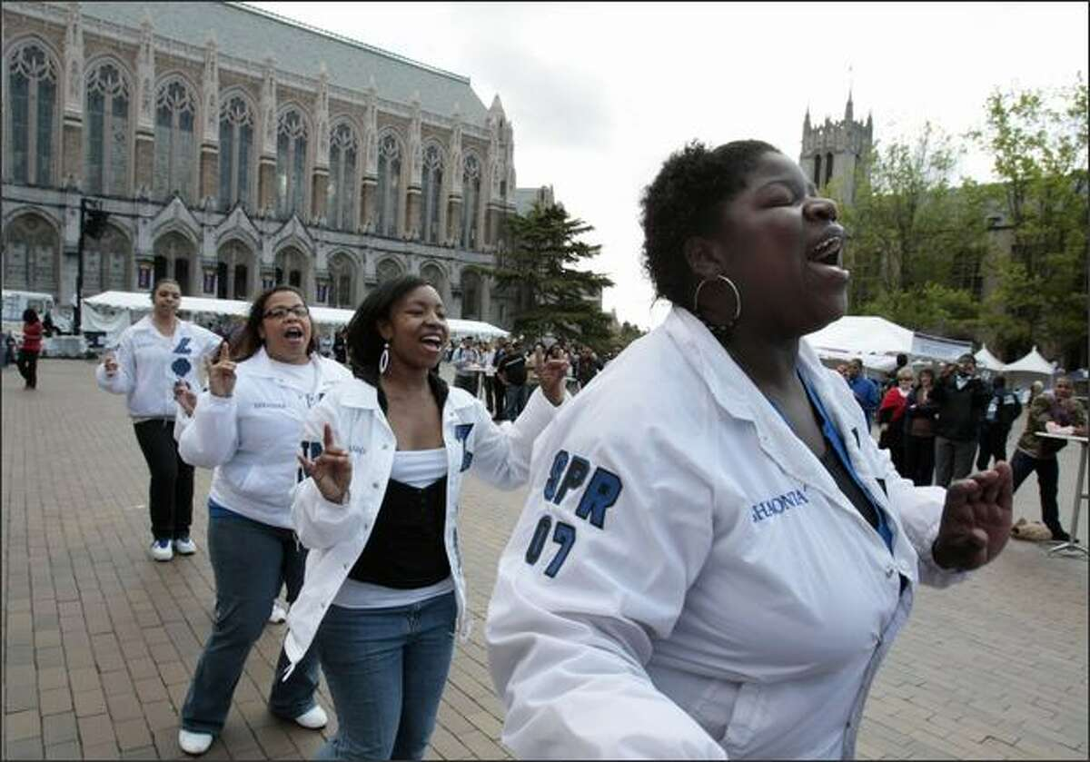 Zeta Phi Beta Sorority Inc. members Shaonta Allen, front, followed by Latasha Green, Lekeisha Harding and Natalie Hart, dance in Red Square on Tuesday as part of a program celebrating 40 years of diversity on the University of Washington campus.