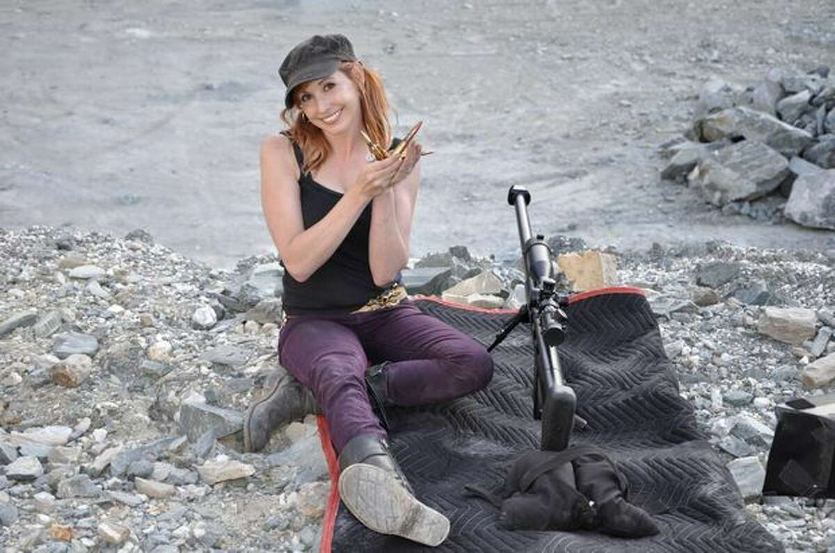 Kari Byron shows a variety of bullets she used in an episode about large guns.