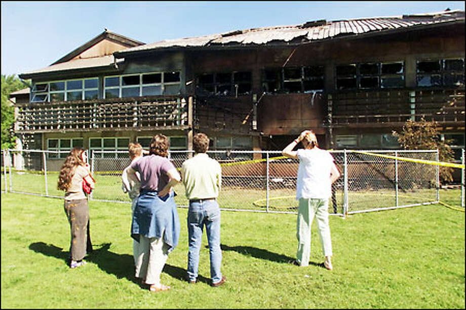 Students and faculty look in disbelief at the remains of the Center for Urban Horticulture at the UW. Archive photo, 2001. Photo: Mike Urban, Seattle Post-Intelligencer / Seattle Post-Intelligencer