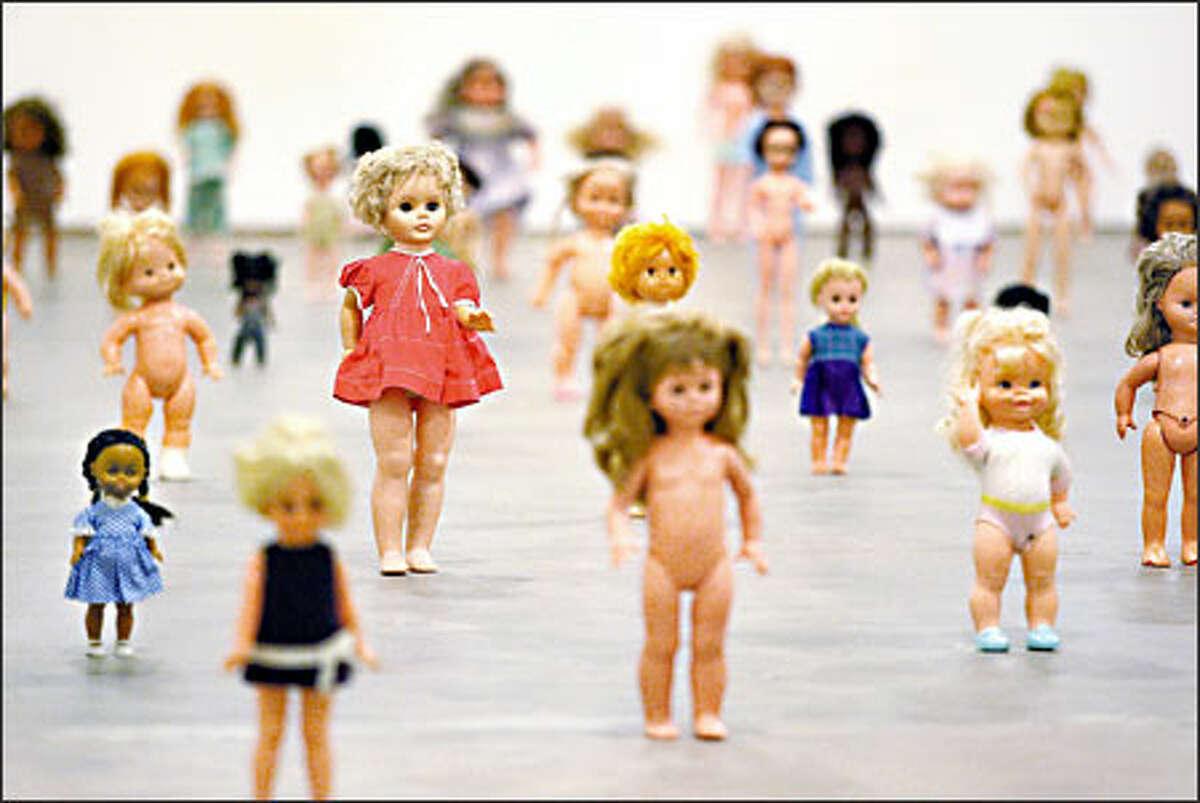 Female dolls, 113 of them, are on parade in New York artist Zoe Leonard's 2000 work,