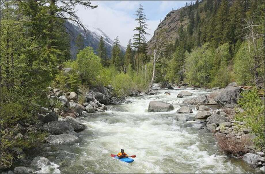 Kayakers run rapids on Icicle Creek in the Wenatchee National Forest near Leavenworth. The grounds of the Leavenworth National Fish Hatchery, on Icicle Creek, would be opened to upland game, big game, and migratory bird hunting under a Trump Administration proposal. Photo: Mike Kane, Seattle Post-Intelligencer / Seattle Post-Intelligencer