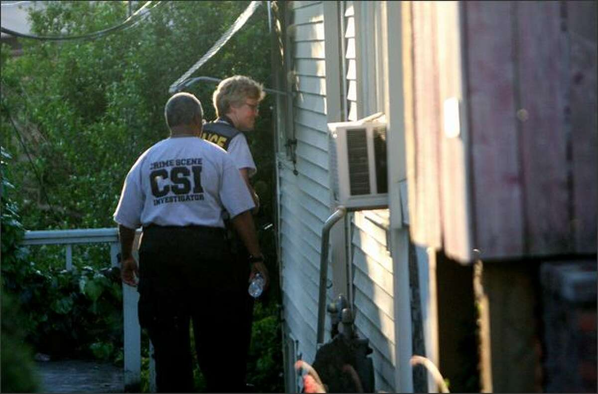 Police officers investigate a business on Eastlake Avenue East that was said to be a brothel.