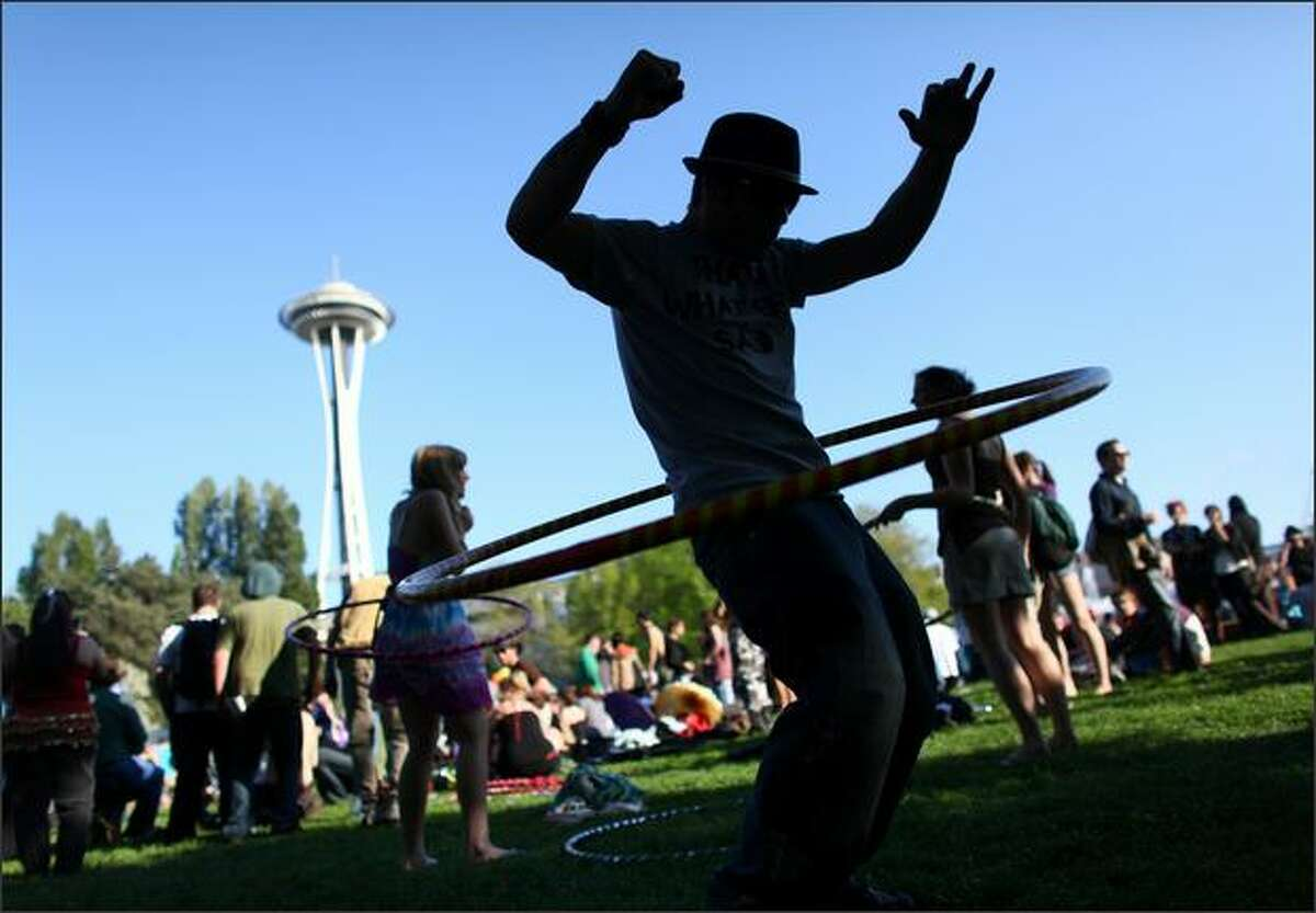 Cody Olesen tries out a hula hoop during the 2009 Northwest Folklife Festival on Friday at the Seattle Center. The festival runs Friday through Monday, 11am - 10pm.