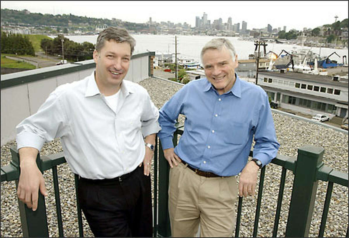 Carl Weissman, president and CEO of Accelerator, said the firm chose to set up a biotechnology incubator in Seattle because of Leroy Hood, right.