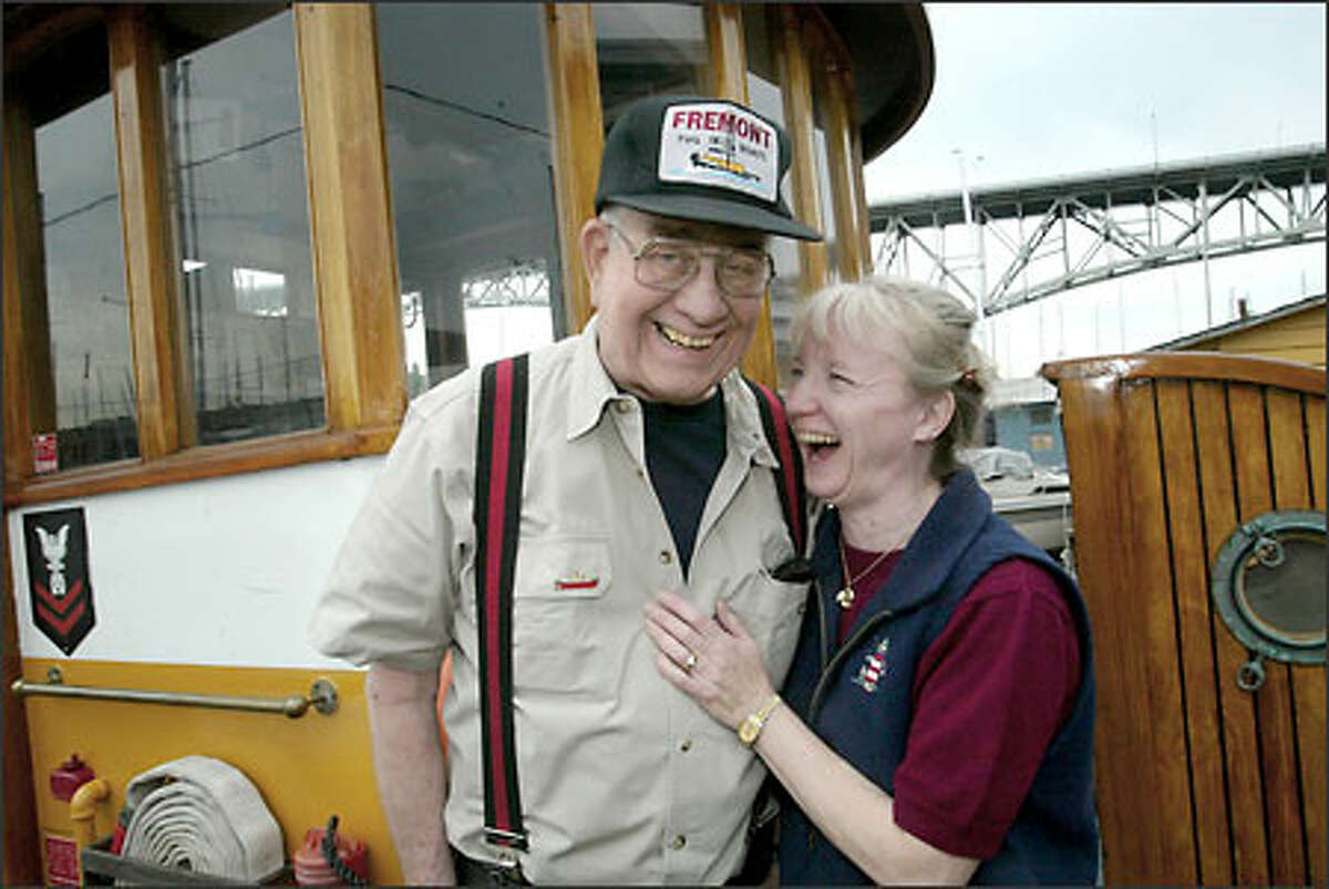 Mark Freeman of the Fremont Boat Co. spends a moment with his wife, Margie, on one of their tugs.