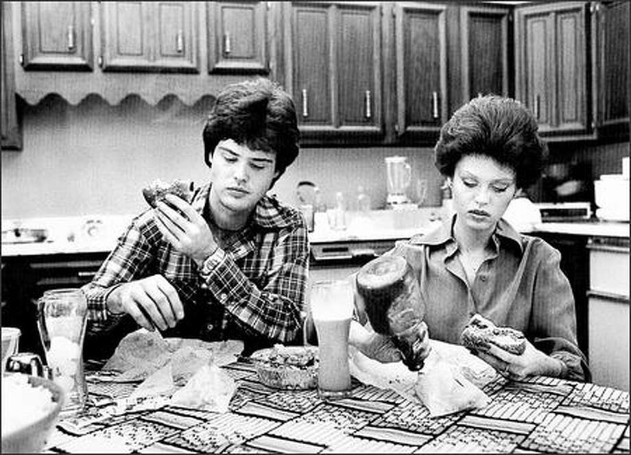 Food is not a pleasure at the Osmond home in 1972. The brother/sister pop stars Donny and Marie were so comfortable with the photographer they didn't bother to impress him.