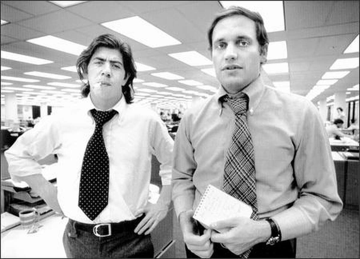 Smoking in the office was still OK at The Washington Post in 1973. Here are Carl Bernstein, left, and Bob Woodward as they were chasing a president out of office by reporting what became known as Watergate.