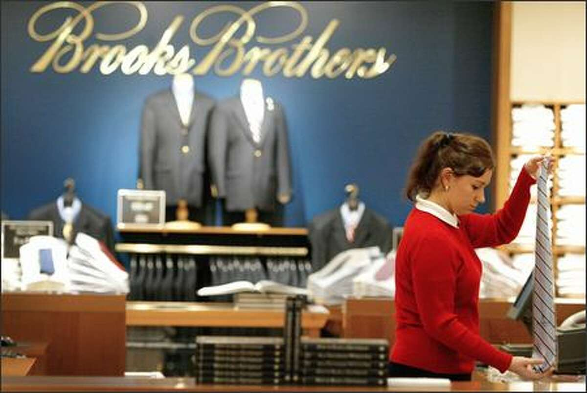 Nichole Korr folds ties at Brooks Brothers, a must-stop store for those whose workplaces are geared toward conservative attire.