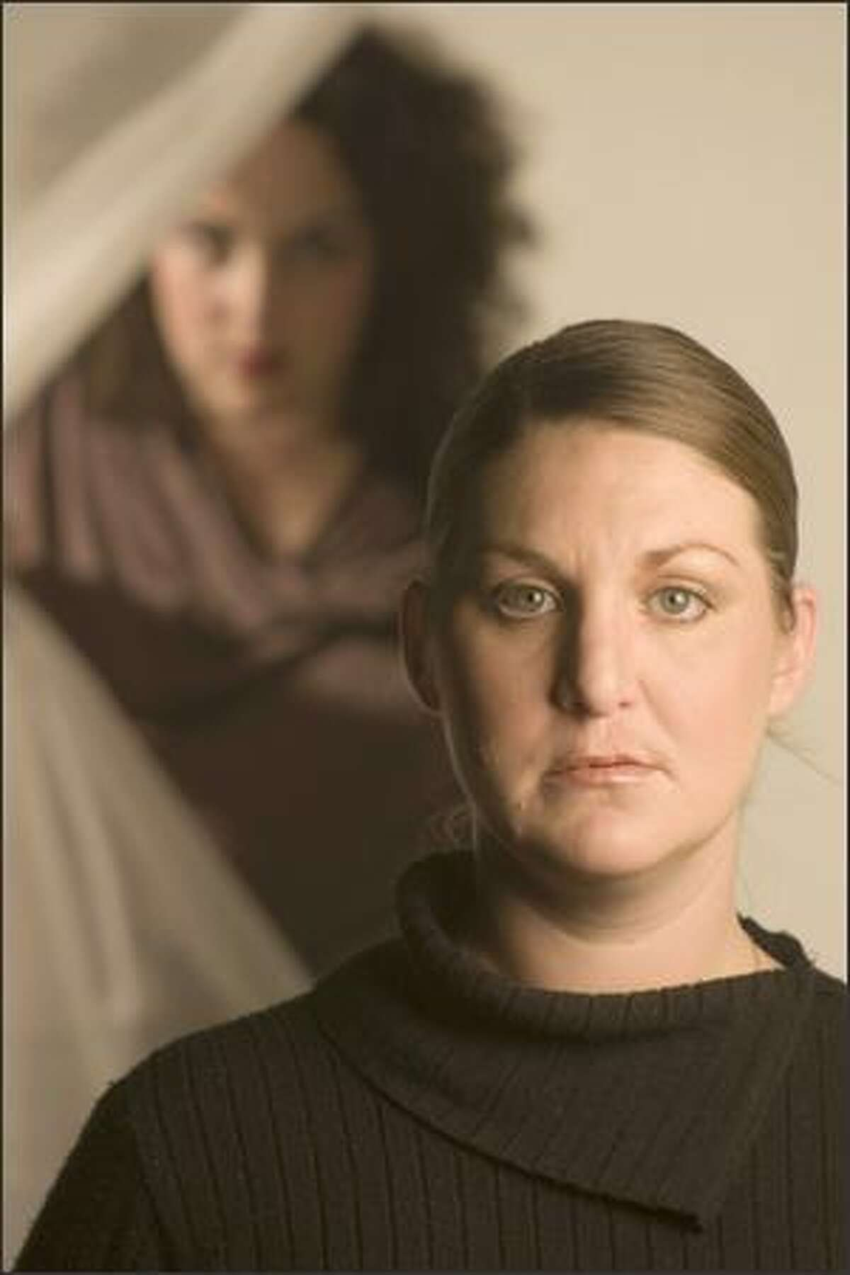 Erica Chiles-Curnutte plays Hamlet and Lisa Hopp is Claudius in the Animus Theatre Project's