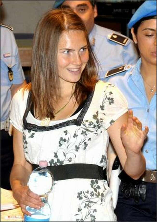 Murder suspect Amanda Knox arrives for a hearing in Perugia, Italy, on Saturday. Photo: Associated Press / Associated Press