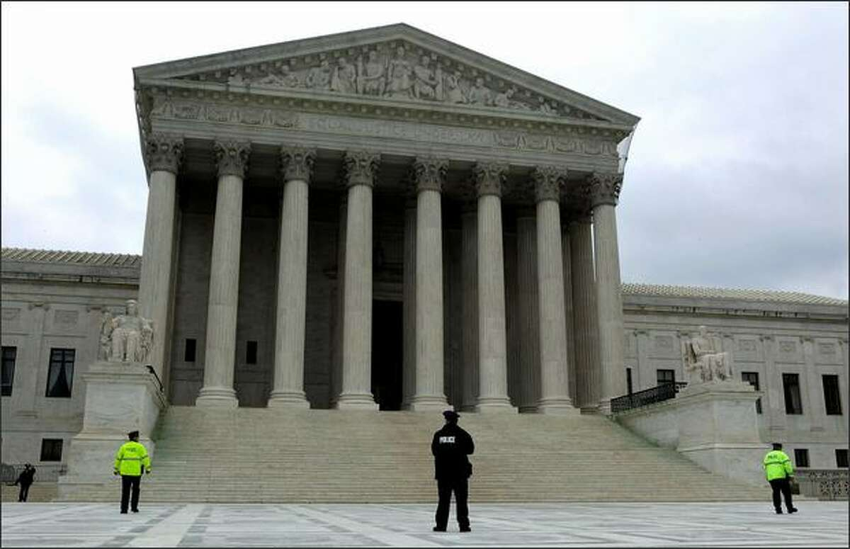 Police stand in front of the U.S. Supreme Court in Washington on May 1.