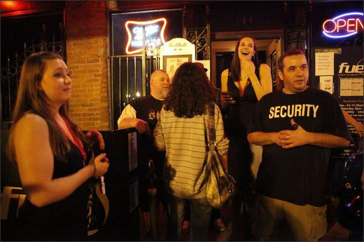 Patrons lounge outside the Fuel night club in Pioneer Square Saturday evening as the former Mary K. Letourneau hosts a