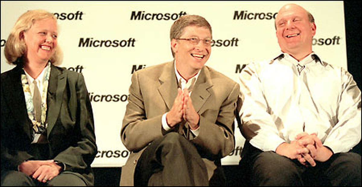 Meg Whitman, president and chief executive officer of eBay; Bill Gates, chairman and chief software architect of Microsoft; and Steve Ballmer, CEO of Microsoft, share a light moment during Microsoft's annual CEO Summit.