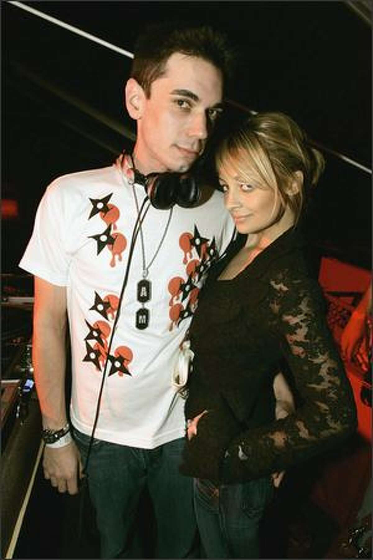 Like a rubber ball, I'll come bouncing back to you. Or not. Adam Goldstein and Nicole Richie are calling it quits for the second time in five months. Maybe he's afraid to embrace someone whose size 0 clothes are beginning to look baggy. Nicole: Eat something!