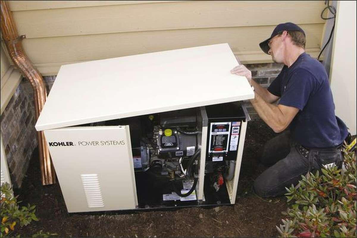 A whole-house standby generator is being installed. Notice the small gas engine inside the housing.
