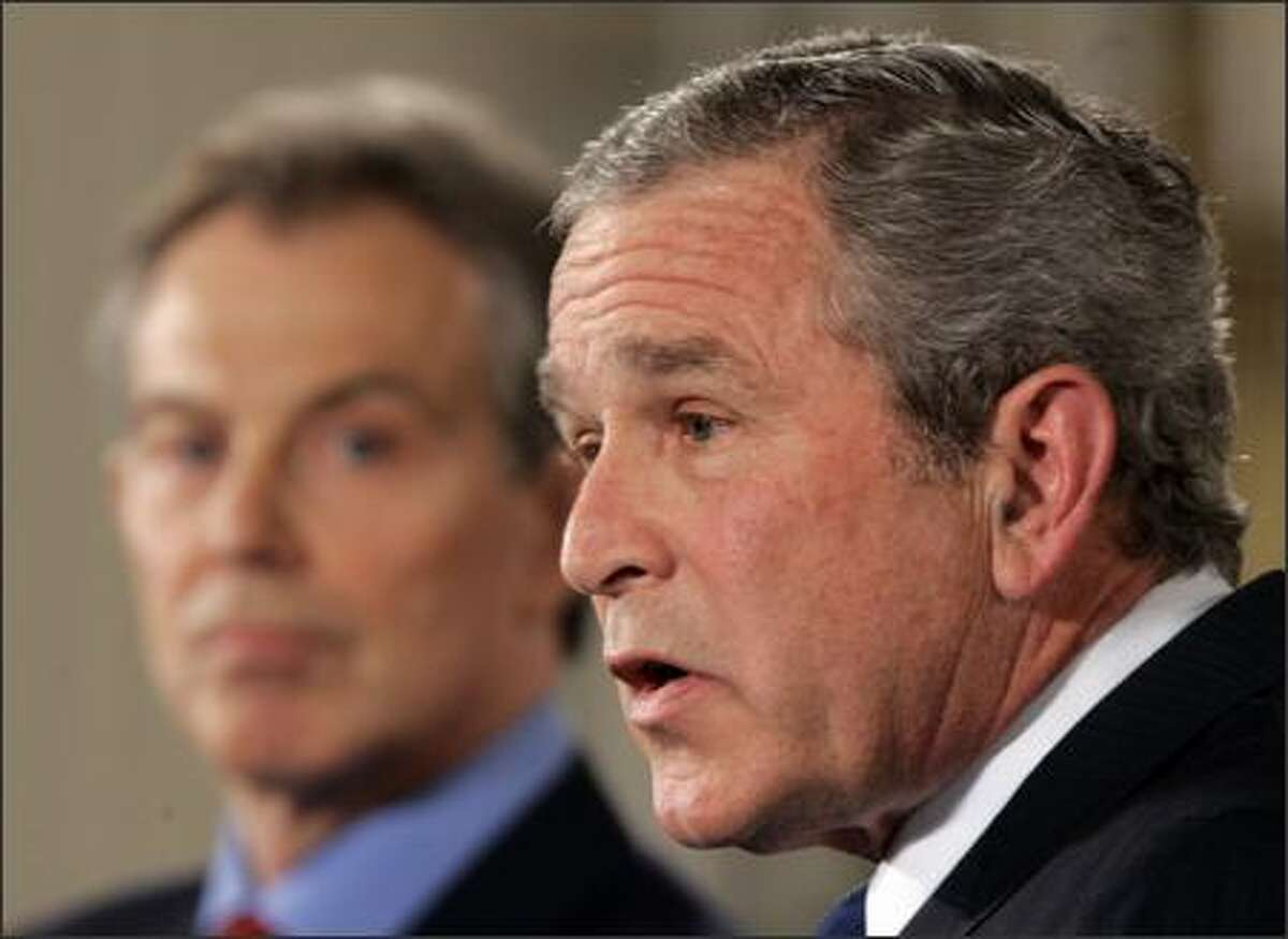 President Bush and Britain's Prime Minister Tony Blair meet the press in the East Room at the White House after their meeting today. Bush and Blair acknowledged difficult times in the Iraq war they launched together in 2003, but both vowed to keep troops there until the new Iraqi government takes control.