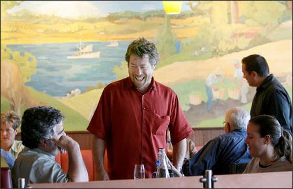 Kurt Beecher Dammeier, center, talks with regulars James Utzschneider and Jenna Miller.