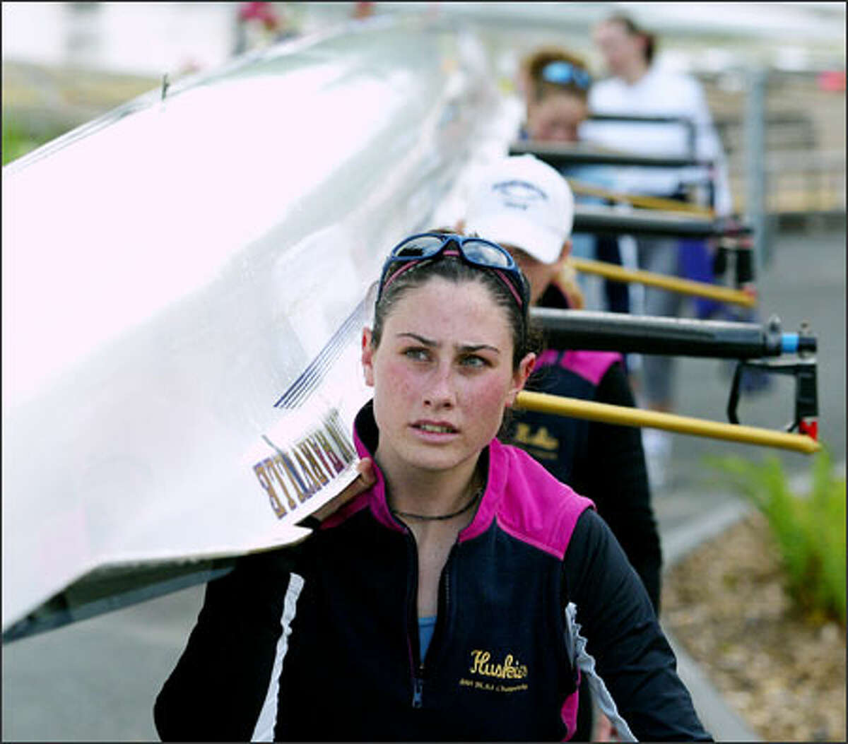 UW rower Marah Connole and her teammates load their boat for the NCAA championship this weekend.