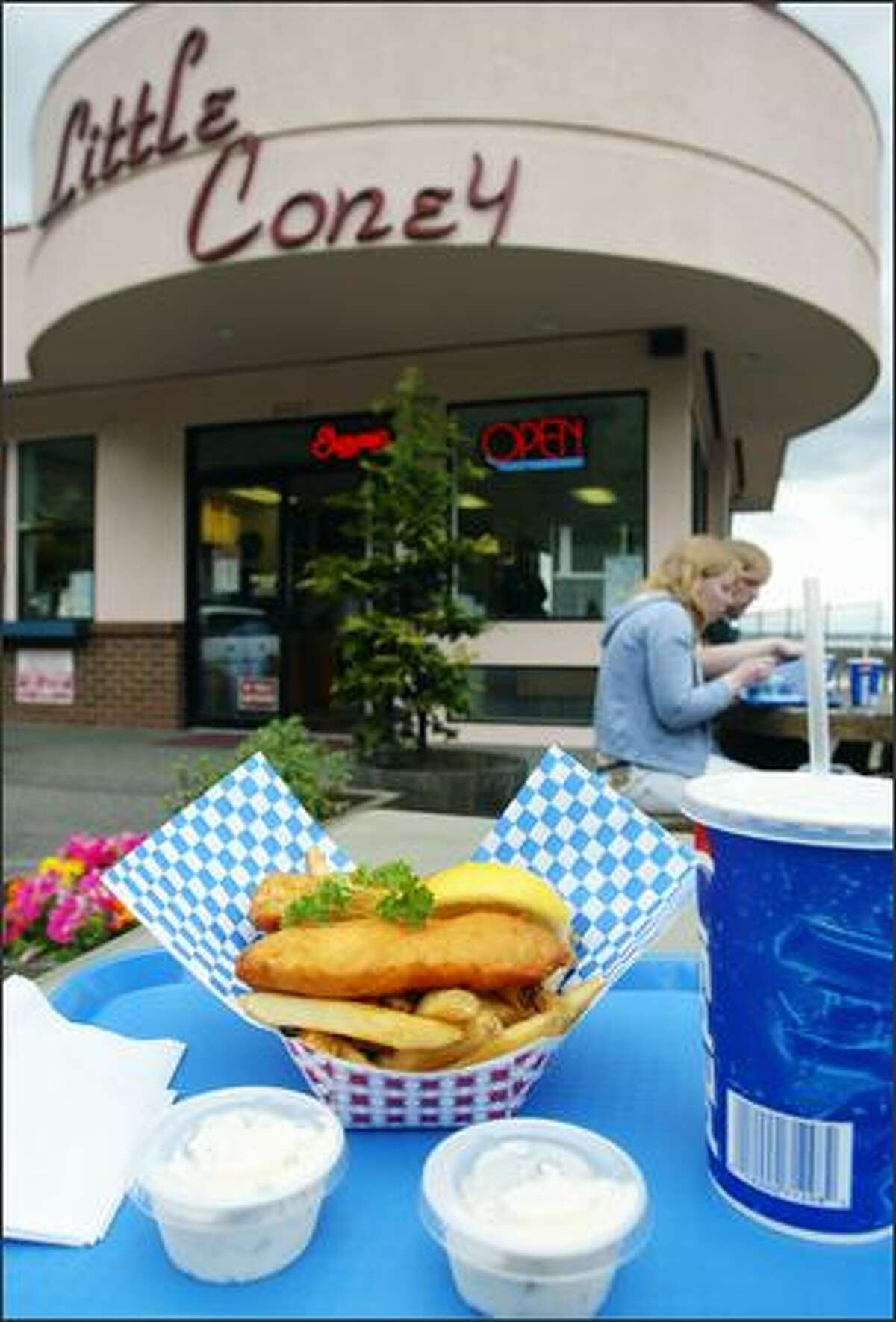 An order of fish and chips is ready for consumption at Little Coney. Indoor and outdoor seating offers views of Puget Sound.