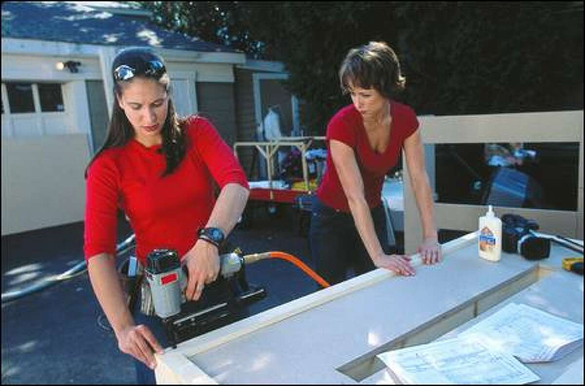 """Part of the popularity of """"Trading Spaces"""" is the cast, including carpenter Amy Wynn Pastor, left, and host Paige Davis. The show is appealing to a wide range of fans."""
