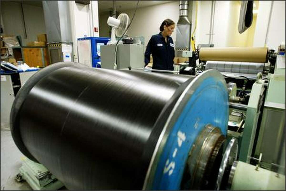 Toray Industries technician Paula Zimmer inspects a roll of
