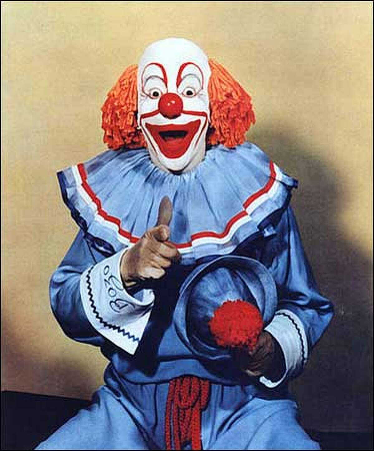 """Vance """"Pinto"""" Colvig portrays Bozo the Clown in this undated file photo. For years Larry Harmon claimed to have created the character. Now the International Clown Hall of Fame is formally endorsing a different version: Capitol Records executive Alan Livingston created Bozo for recordings in 1946, and the late Colvig was the first person to play the clown. On Friday, the hall is posthumously inducting Colvig as the first Bozo. (AP Photo/Photo courtesy International Clown Hall of Fame)"""