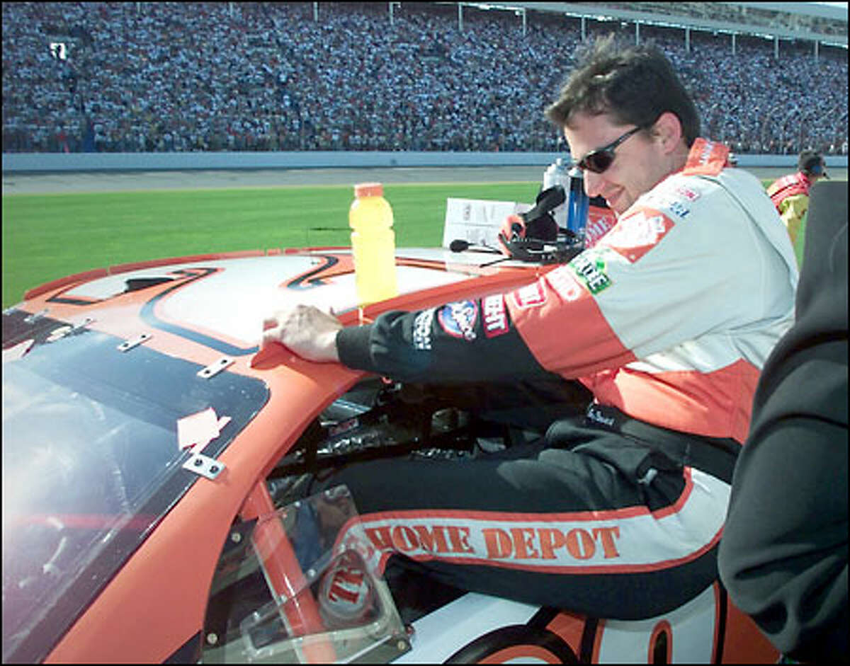 Tony Stewart, sixth in the Indianapolis 500 earlier in the day, climbs into his race car for the Coca-Cola 600 in Concord, N.C., where the finished third in a remarkable race-day double.