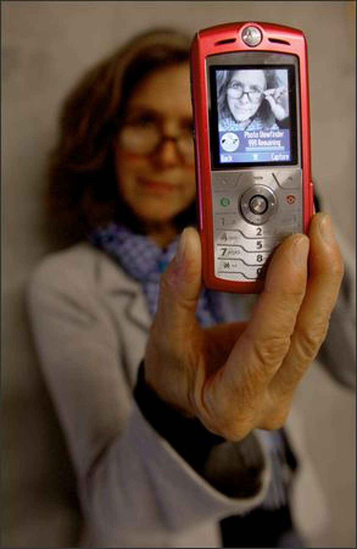 """""""It's a thing of beauty,"""" photographer Colleen Chartier says of her cell phone, the camera of which she used to create a text-photo story for a group exhibit at Western Bridge titled, """"You Complete Me."""""""