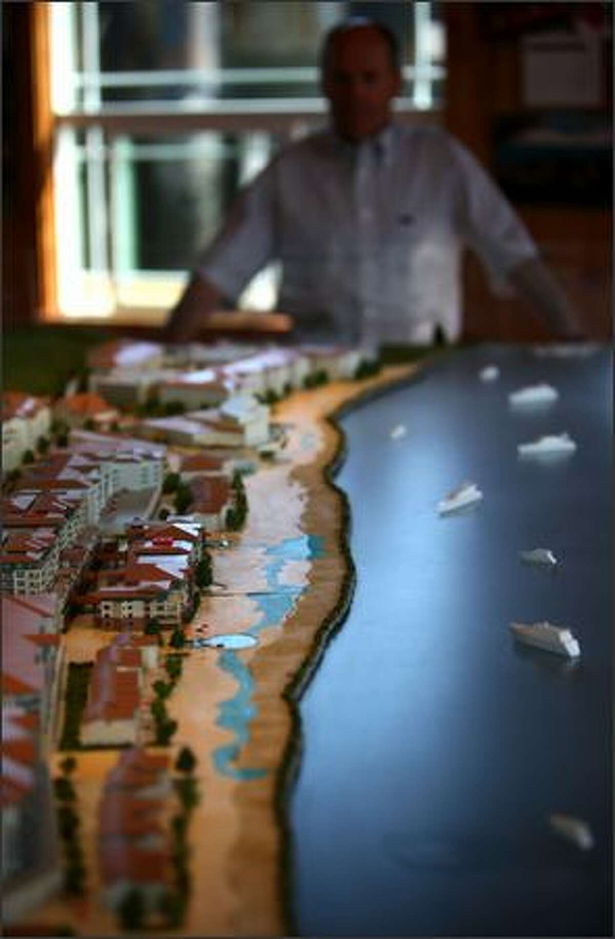 A model of the waterfront development is shown aboard the M/V Steilacoom ferry.