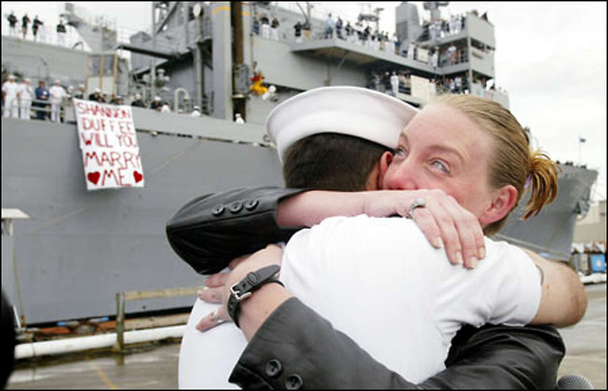 Sailor Robert Kovacs surprises his girlfriend, Shannon Duffee, by proposing to her after disembarking from the USS Bridge after it pulled into port yesterday in Bremerton. Duffee said yes. The Bridge, a supply and replenishment ship, was on a prolonged tour of duty in the northern Arabian Sea.