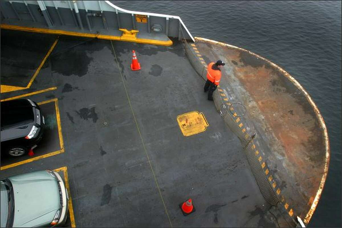 The Washington State ferry M/V Walla Walla crosses from Edmonds to Kingston while a deck hand watches its progress in this October 2007 file photo.