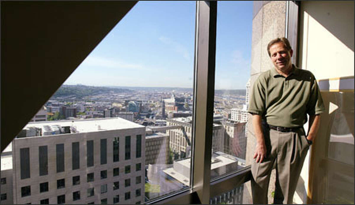 Ken Johnsen's office on the 24th floor of the Seattle Municipal Tower overlooks two buildings his firm, Shiels Obletz Johnsen, has managed for the city. At left is the Justice Center and, at center, the new City Hall.