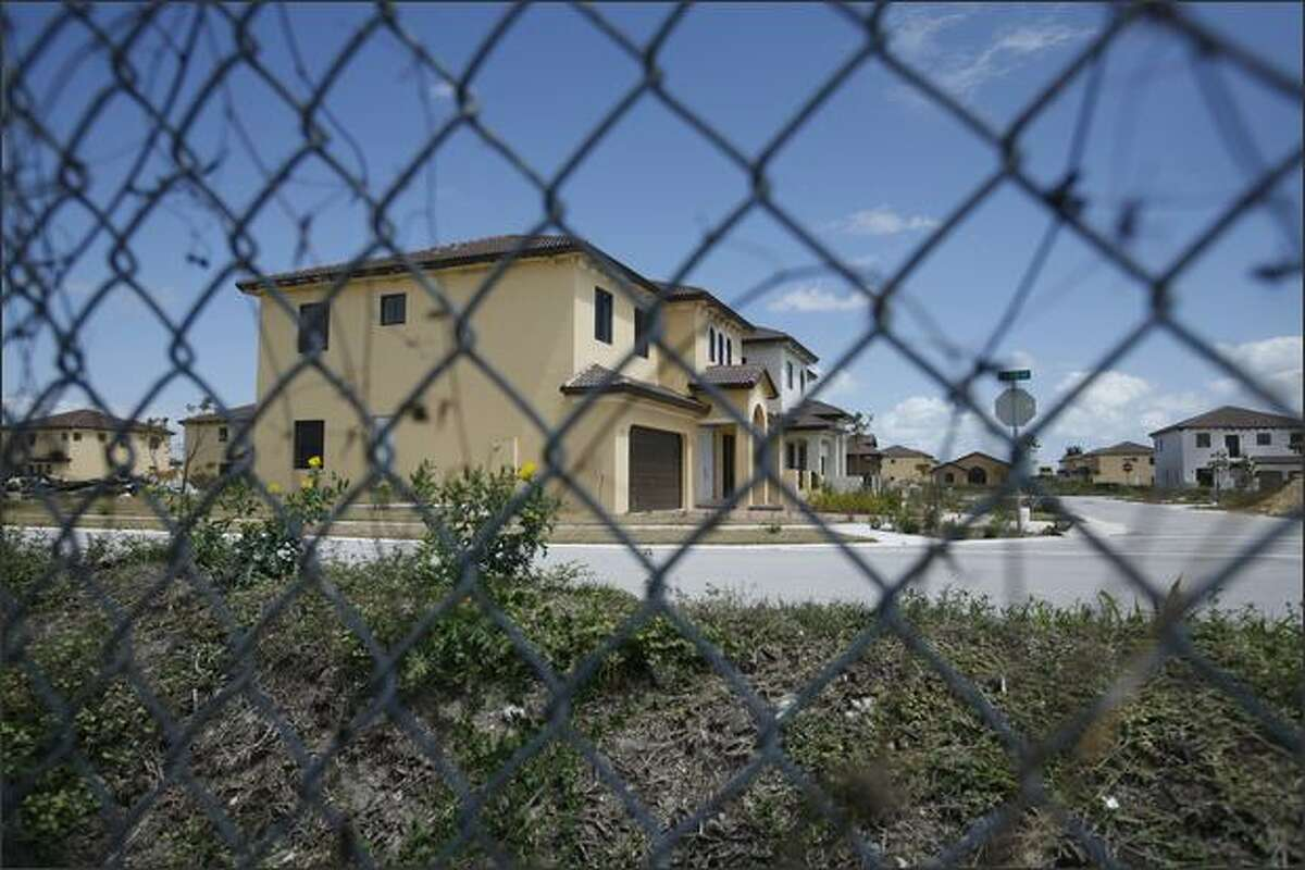 In this March 24, 2009 file photo, unfinished houses sit empty in a Homestead, Fla., development where the builder ran out of money and stopped construction. (AP Photo/J Pat Carter, File)