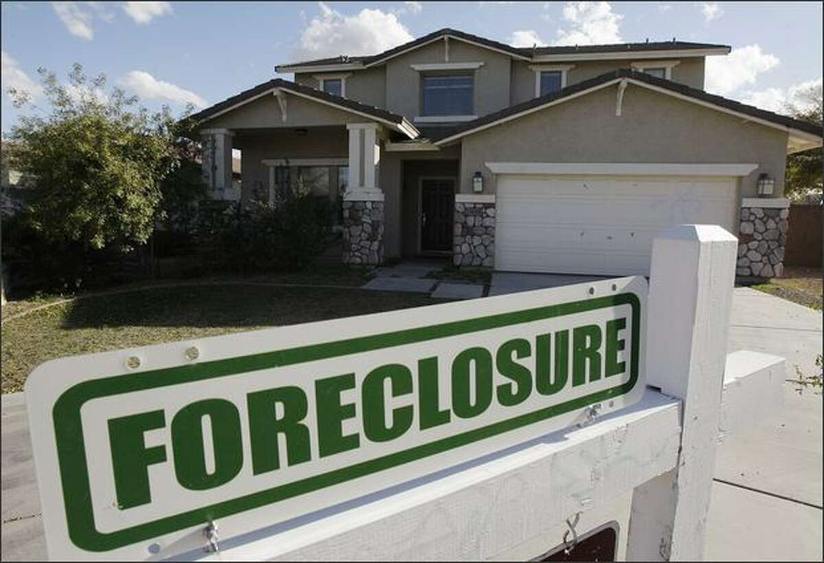 In this Feb. 17, 2009 file photo, a foreclosure sign sits outside a home for sale in Phoenix. Arizona has one of the highest foreclosure rates in the country. (AP Photo/Ross D. Franklin, File)