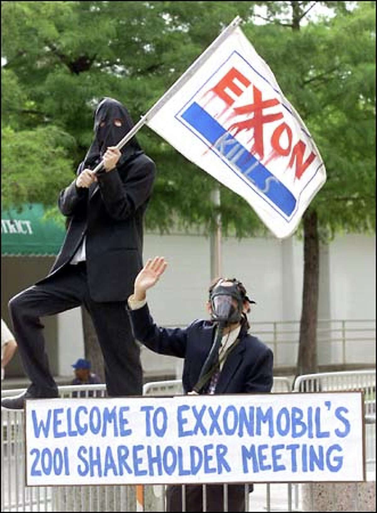 Protesters gather near the entrance to the Exxon Mobil shareholders meeting in Dallas. About 130 people showed up yesterday to demonstrate, calling for renewable energy sources and an end to work-place discrimination. At the meeting, Exxon Mobil shareholders voted to reconsider next year whether to amend company policy and ban discrimination based on sexual orientation. Shareholders voted against several other amendments, including promotion of wind, water and solar power, linking executive pay to the company's environmental and social record, and a proposal to prepare a report on the effect of drilling in the Arctic National Wildlife Refuge.