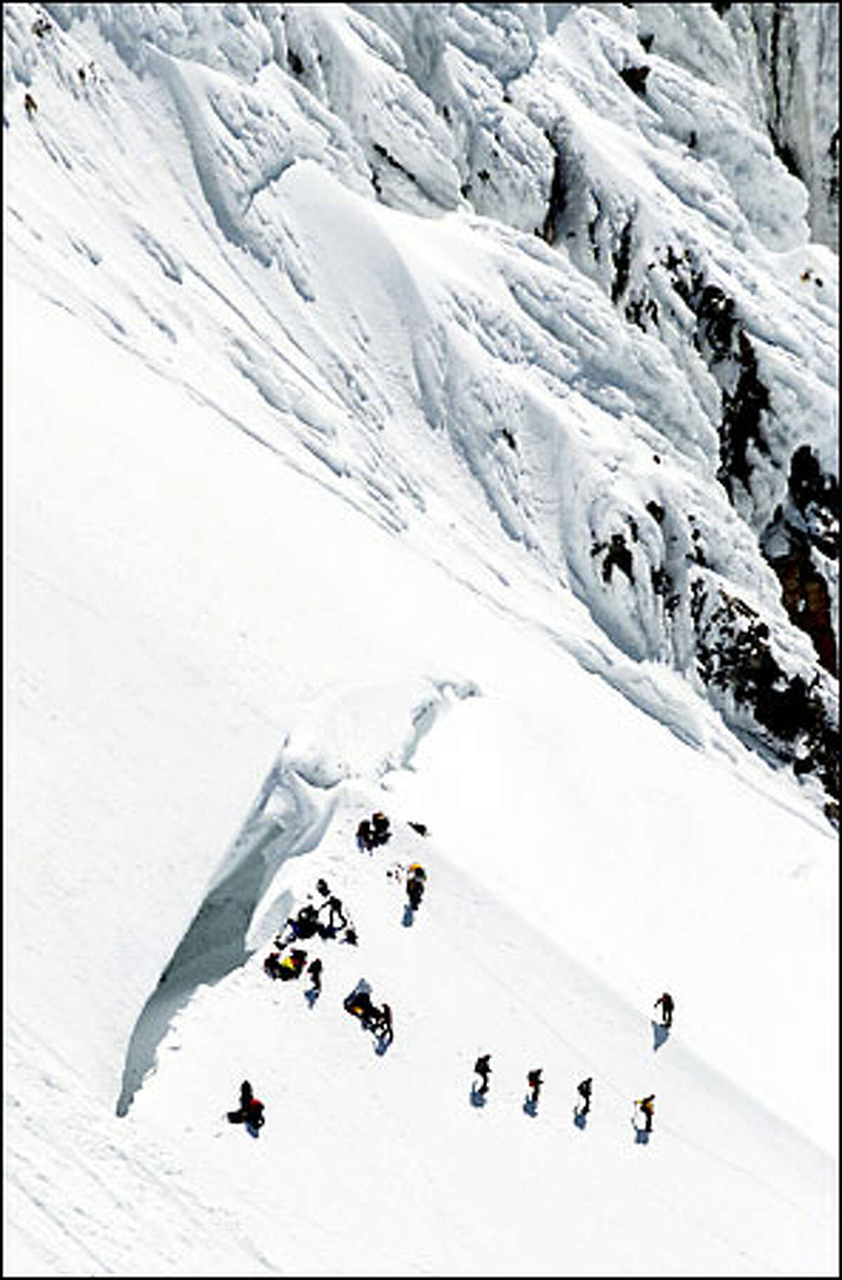 Rescuers converge near the summit of Mount Hood, where nine climbers fell into a crevasse yesterday. Three died and two others were injured.