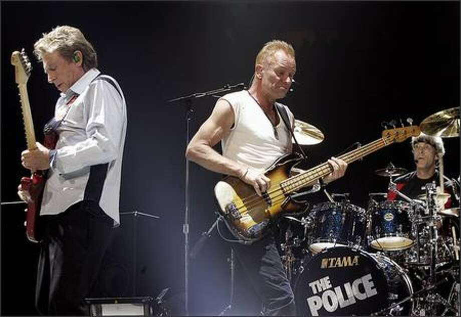 Andy Summers, left, Sting and Stewart Copeland opened the tour Monday in Vancouver, B.C. Photo: Associated Press / Associated Press