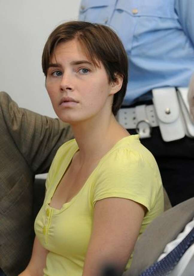 Amanda Knox attends a preliminary hearing in Perugia, Italy, Tuesday, June 1, 2010. Knox has appeared in court for the first time since her murder conviction to face charges she slandered police by saying she was beaten during questioning over the death of her British roommate Meredith Kercher in 2007. (AP Photo/Fabrizio Troccoli) Photo: Associated Press / Associated Press