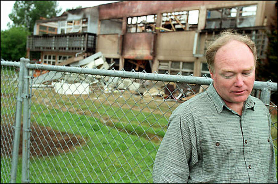 Toby Bradshaw, a researcher at the Center for Urban Horticulture, walks in front of the charred remains of the building. Bradshaw's office was the target of the May 21 firebomb. Photo: Paul Joseph Brown, Seattle Post-Intelligencer / Seattle Post-Intelligencer