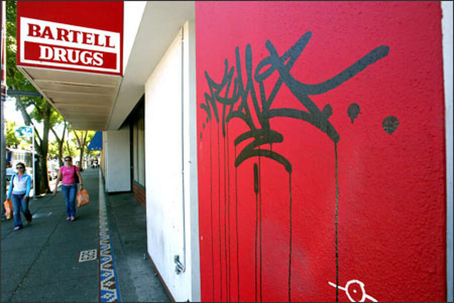 The empty building that once housed QFC and Bartell Drugs has become a magnet for graffiti. Photo: Grant M. Haller, Seattle Post-Intelligencer / Seattle Post-Intelligencer