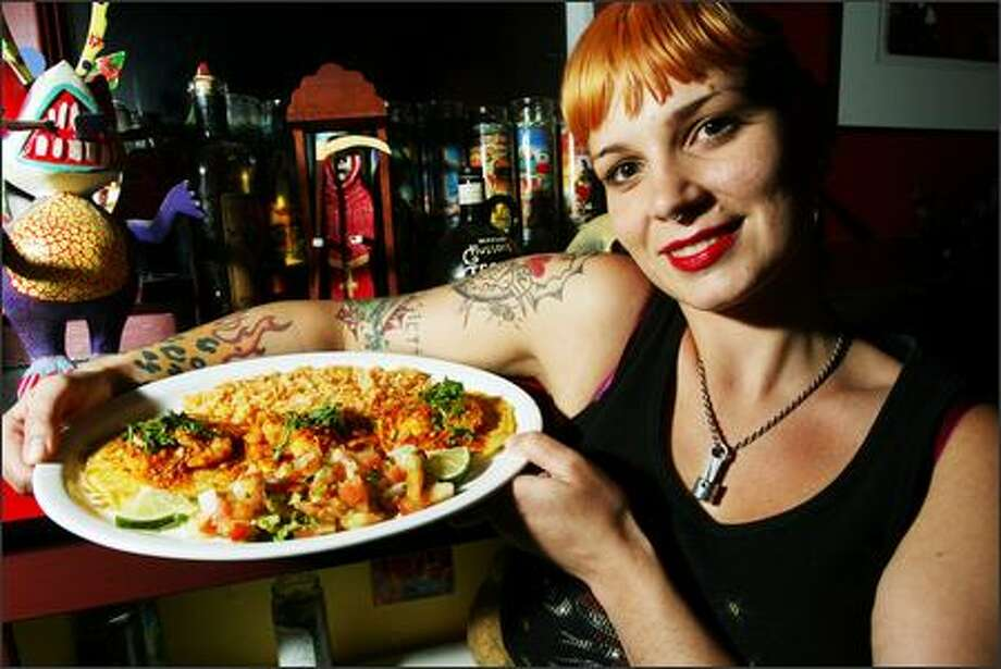 El Chupacabra bartender Rachel Lush with a plate of Tequila Camarones served on cornbread pancakes with rice and salsa. Photo: Grant M. Haller, Seattle Post-Intelligencer / Seattle Post-Intelligencer